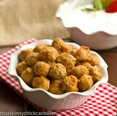 Buffalo Chicken Meatballs... delish! Do not use a flat cookie sheet, the juices made a mess of my oven :(