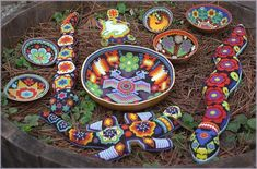 Mexican Huichol Indian bead art: gourd offering bowls, serpents, an iguana, and a turtle with a white deer on its back. Amazing.