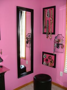 Mirror, ottoman, accessories mounted nearby on wall creates a nice corner to use as a dressing area.