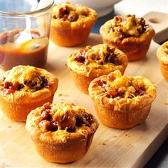 Farmhouse Barbecue Muffins Recipe -Tangy barbecue sauce, fluffy biscuits and cheddar cheese combine to make these hearty muffins. Try them with ground turkey or other shredded cheeses to vary the flavor. —Karen Kenney, Harvard, Illinois
