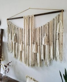 This is a MADE TO ORDER hanging. Please allow up to 2 weeks for completion. This hanging is full of twists, macramé, tassels and braids. It would look great above a bed or sofa. MATERIALS: Acrylic/wool yarns, rustic stained wooden dowel, wooden beads, jute twine. COLOR: Creams Feather Wall Decor, Diy Wall Decor, Macrame Art, Macrame Projects, Yarn Wall Hanging, Wall Hangings, Wall Art Crafts, Macrame Plant Hangers, Macrame Tutorial
