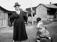 Older gentleman and child, Anyang, South Korea, 1953. Windfield Photographic Collection, Ontario Canada, by Capt. Claxton Ray