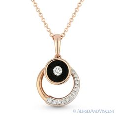 The featured pendant is cast in 14k rose gold and showcases a circle design adorned with round cut diamonds halfway around and topped by a round bezel set with a round cut diamond and finished with black enamel.