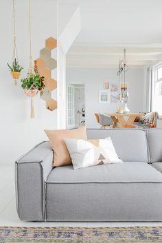copper mirrors , macrame plant holders , neutrals , grays, geometric pillow