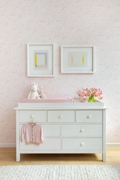Simple and sweet- Here a girl's nursery is designed with a white changing table, pink nursery wallpaper and a woven rug layered over blond hardwood floors. White Changing Table, Nursery Wallpaper, White Wallpaper, Co Design, Dining Nook, Loft Spaces, Nursery Design, Nursery Decor, Pink Walls