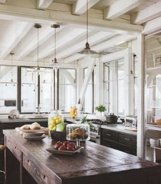 lots of windows, white and clean with rustic elements