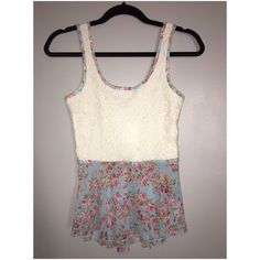 Peplum top. Lace and floral print chiffon. Cute peplum tank! Lace on top. See through back. Rue 21 Tops Tank Tops