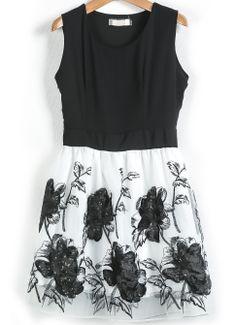 elegant, lovely print on the skirt ..   Black Sleeveless Embroidered Sequined Chiffon Dress US$36.67