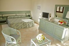 Rooms & Suite with Jacuzzi in Pula - Baia di Nora Hotel, Pula, Sardinia Pula, Sardinia, Jacuzzi, Rooms, Table, Furniture, Home Decor, Bedrooms, Decoration Home