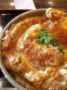 """"""" Katsu-don """" is a traditional and famous bowl cuisine that has a breaded and (deep‐)fried pork cutlet over the rice. #Japan"""