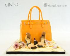 Hermes cake.  Bag cake with gum paste high heels and flowers.