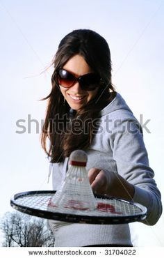 Young woman with badminton racquet - stock photo