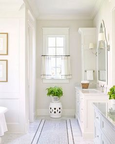 Ivory white bathroom designed by @sarahbartholomewdesign.