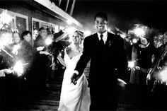 """Sparkler exit at midnight at Salty's in Seattle, WA. This was a winning image in PDN (Photo District News) """"Top Knots"""" wedding photography contest in 2004."""