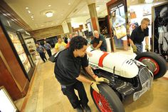 A historic Indy 500 car is loaded into Macy's Herald Square in NYC as IZOD presents 100 Years of Indy Racing, Fashion and Design.