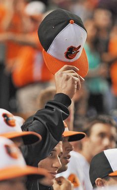 Manny Machado tips his cap to the crowd after fans give him a standing ovation, honoring the third baseman a day after suffering a season-ending injury. (I was there cheering!)