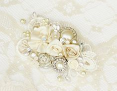 Ivory Bridal Hair Comb- Ivory Clip with Flowers,Rhinestone, Pearls-Vintage Inspired Hair Piece- Floral Wedding Hair Accessories- Fascinator. $59.00, via Etsy.