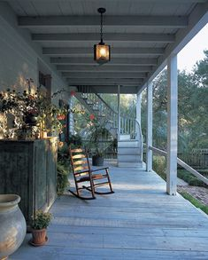 porch with rocker. like the old cupboard and the arrangement on top of it.