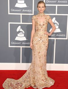 """Taylor donned her most mature look on the red carpet, sparkling in a silk Zuhair Murad mermaid gown. """"It's one of my favorite dresses I've gotten to wear,"""" she told Seacrest before the show. """"I saw it months ago, and I said 'We've got to save this for the Grammys.'"""" We can see why!"""