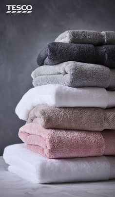 Pile up the softest towels, in shades of blush, mink, white and grey, to create a hotel-feel bathroom space.