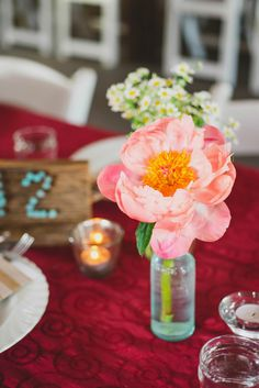 pink peony in aqua glass // photo by June Cochran, flowers by Cori Cook Floral Design // View more: http://ruffledblog.com/colorado-country-wedding/