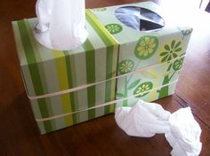 From Real Simple: Rubber band an empty tissue box to your current box when you have a cold. Puts an end to the gross tissue pile. Good thinking!