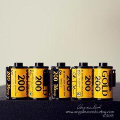 Kodak film images photo Kodak gold 200 film photos still Life rolls of film analog yellow black photography under 50 USD) by AngsanaSeedsPhoto Black Photography, History Of Photography, Kodak Photos, Kodak Gold, Photographic Film, Classic Camera, Film Images, Vintage Cameras, 35mm Film