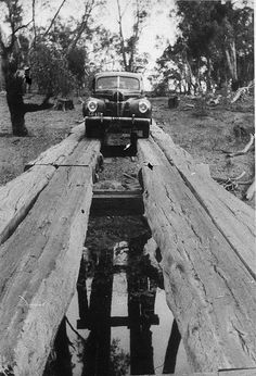 1940 Ford V-8 or Mercury car crossing Woolooma-Balpool bridge - Deniliquin, NSW, 1930 by Garry Daly by State Library of New South Wales collection, via Flickr