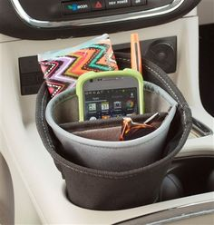 Convert a car cup holder into a storage and organization center that charges a mobile phone! The High Road Ultra DriverCup has 4 pockets to store driving necessities while charging on-the-go. A cord port in back lets you plug into any car power socket and keep a cord contained and ready to charge. Come see it at www.highroadorganizers.com