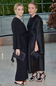Identical style: Identical twins Mary Kate and Ashley Olsen chose almost identical outfits...