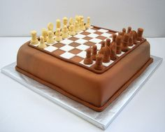An edible chess board for an 11 year-olds birthday. The chess pieces are made from gum paste and are completely edible and each piece is molded to look like its inedible counterpart. When I deliver…