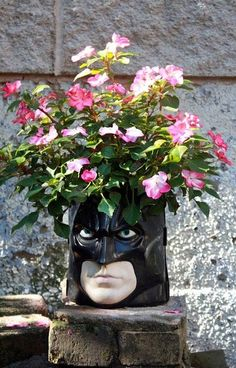 planter made from a Halloween bucket; too bad I can't get my hands on one, but clever to think outside the box for stuff in the yard