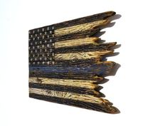 The Thin Blue Line American Flag This American flag is a BellaRemi Designs original inspired from the tragedies that our men in blue have been facing recently and the day to day service they provide, placing their lives on the line. It is truly a one of a kind American flag crafted from 13 individual hand-selected reclaimed wood planks, painstakingly carved to accentuate the grain of the wood, then hand-painted and distressed to give it a tattered, ragged, rustic, and antique appearance…