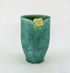 Oval aqua ceramic vase with white floral design by GlendaJordan, $38.00 Etsy