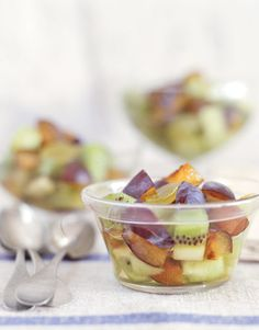Toss slices of red and purple plums with pieces of honeydew melon, kiwi fruit, and sliced grapes in a simple herb-infused syrup for a refreshing breakfast-as-dessert. #recipes #brunch