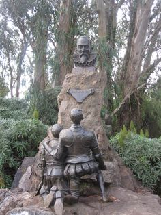 1916 Memorial sculpture in bronze and natural stone of Don Quixote and Sancho Panza kneeling before a bust of Miguel de Cervantes in Golden Gate Park, San Francisco, United States. 300 years since the death of the author in Bronze Sculpture, Sculpture Art, Death Of The Author, Man Of La Mancha, Dom Quixote, Don Miguel, Golden Gate Park, Outdoor Sculpture, Fantasy Landscape