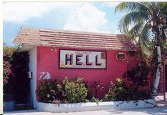 Welcome to Hell.and yet it looks like a dive bar with a great old jukebox, a patio, and the perfect margarita. I guess I am driving the bus, haha! All ABOARD! Cool Places To Visit, Great Places, Places Ive Been, Perfect Margarita, Dive Bar, Cayman Islands, Jukebox, Diving, Vacations