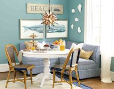 We used coastal-inspired artwork to give this little breakfast banquette a personality that will transport even the most landlocked folks straight to the sand and sun.