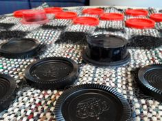 When some of the checkers for this oversized checker board went missing, they replaced them with painted apple sauce containers. A very creative idea.