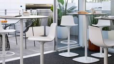 Enea Lottus Tables and Barstools - These would be a smart look for meet-up tables in the IT department.