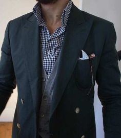 Mens street style fashion: navy blue blazer jacket, grey cardigan, blue checkered shirt, pocket square, vintage glasses