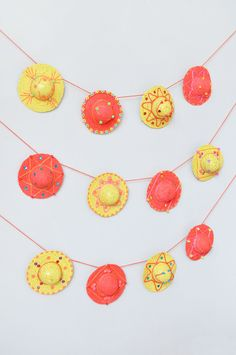 Turn doll hats into sombreros for a fun Cinco de Mayo garland!