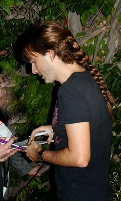 David Tennant. In pigtails. BRAIDED pigtails. You're argument is SO invalid, it won't even be considered at this time.