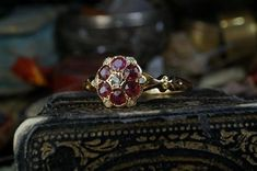 New. An 18 carat gold ruby & diamond cluster ring online now.