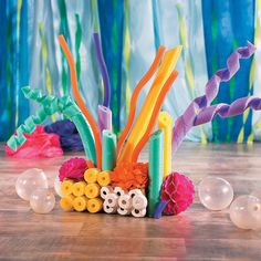 If you're having an Under the Sea VBS, this  coral reef decoration is a must! Click for instructions on how to turn pool noodles into this DIY decoration for VBS.