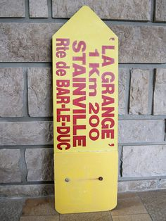 Vintage road sign in yellow and red metal. This advertising sign indicated the road to go to the restaurant La grange (The barn) of Stainville (Meuse, France).   #vintage #french #industrialdecor #industrial #industrialdesign #industrialfurniture #signs #advertising #advert #antiques #retro #restaurantfurniture #restaurantdesign