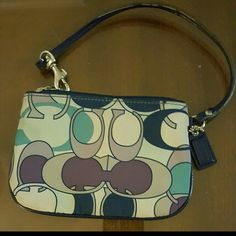 Authentic Coach wristlet Very cute wristlet is made of a soft vinyl like material. It is 6 inches in length & 4 inches tall. Excellent condition. Coach Bags Clutches & Wristlets