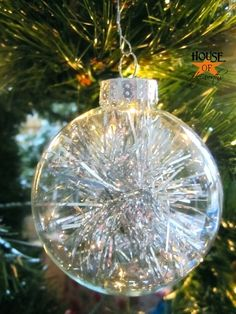 Tinsel filled ornaments by House of Hepworths.  Clear glass balls filled with snips of tinsel garland.