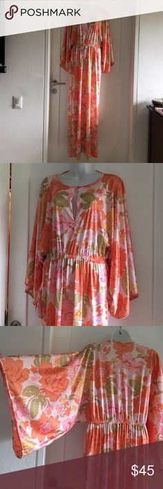 Vintage Vanity Fair Nylon Maxi Dress size Small Vintage 70's Pink Coral Floral Empire Vanity Fair nylon maxi dress Size small. Fits like a medium. Beautiful print and bright colors. Angel wing sleeves. Please look at pictures for better reference. Happy shopping!! Vanity Fair Dresses Maxi