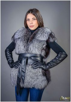 Nice fur vest cinched with a wide leather obi-style belt. Love those long black leather gloves!